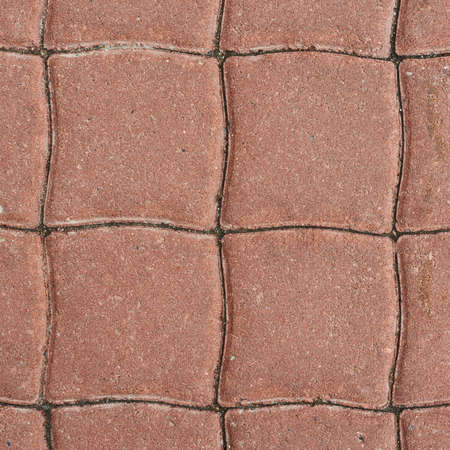 Tiled with paving stone bricks path's fragment as an abstract background Stock Photo - 21906286