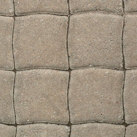 Tiled with paving stone bricks path's fragment as an abstract
