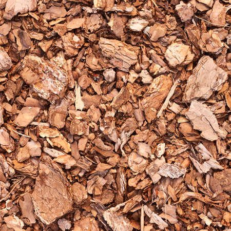 Wooden mulch ground fragment as abstract background composition photo