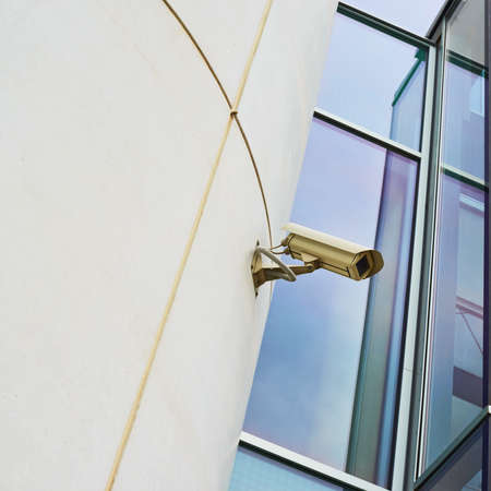 CCTV camera on the office buildings wall photo