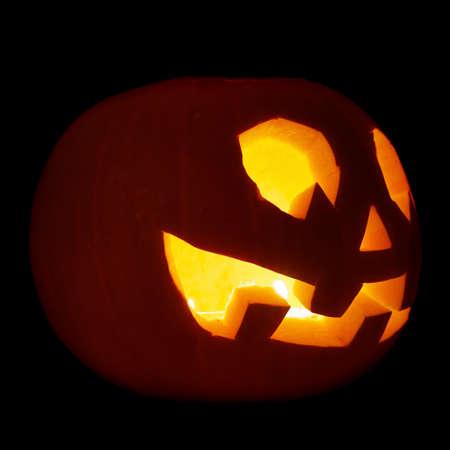 Glowing Jack-o-lantern pumpkin isolated over black background Stock Photo