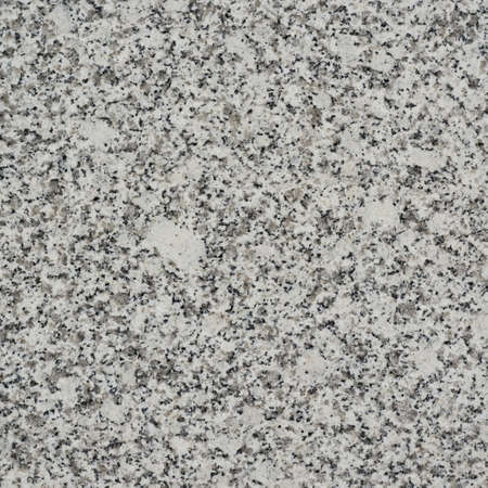 polished granite: Polished granite fragment as a texture background
