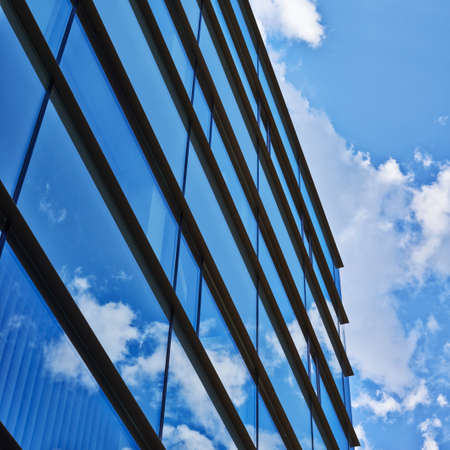 Blue cloudy sky reflection in the office building's windows composition Stock Photo - 23053826