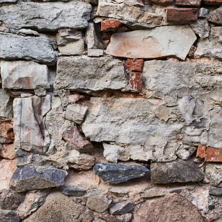 Old stone wall fragment as abstract composition photo