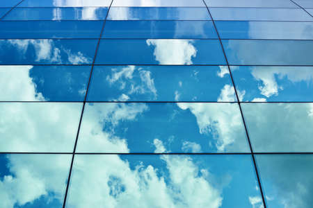 Blue cloudy sky reflection in the office building's windows composition Stock Photo - 23109906