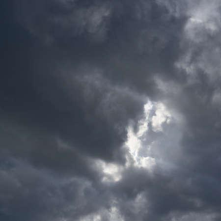 Sun hidden behind the rain clouds composition photo