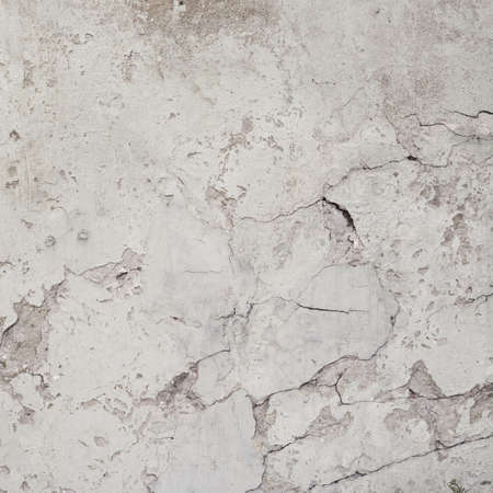 Old cracked covered with white lime wall surface as abstract background composition