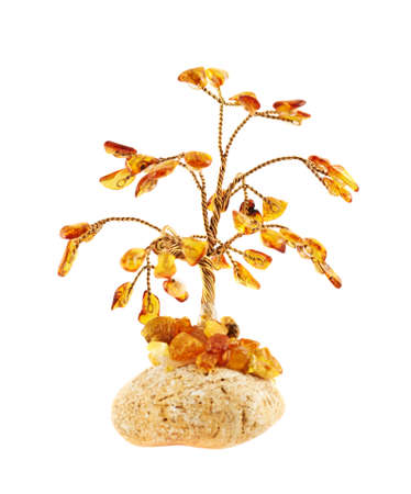 Tree statuette made of amber stones, isolated over white background