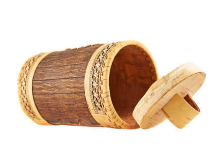 Handmade wooden cylindrical case, lying on its side, isolated over white background photo