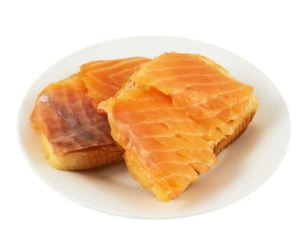 Two salmon sandwiches in a plate, isolated over white background photo