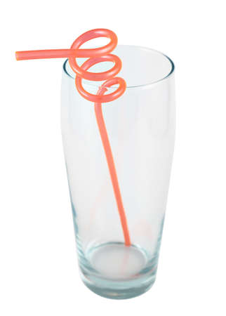 Tall empty glass with a plastic straw inside, isolated over white background photo