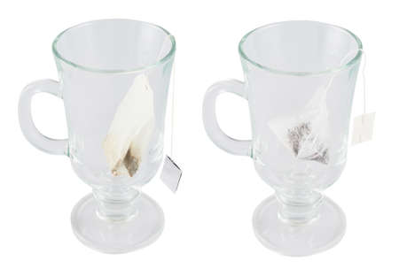Glass teacup with a tea bag inside isolated over white , set of two foreshortenings photo