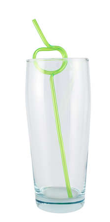 Tall empty glass with a plastic straw inside, isolated over white  photo