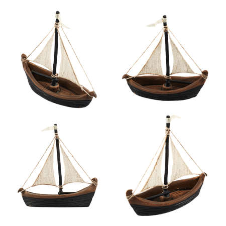 Sailboat statuette figure isolated over white , set of four foreshortenings photo