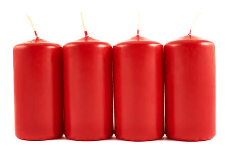 Red wax candle composition isolated over white  photo