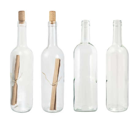 closed corks: Transparent glass bottle isolated over white background, set of four, with the message and empty Stock Photo