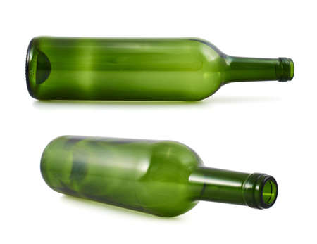 Empty green glass bottle lying on its side, isolated over white background, set of two foreshortenings photo
