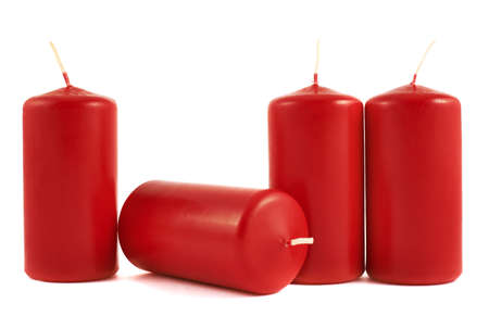 Red wax candle composition isolated over white background photo