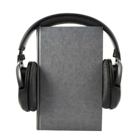 Audio-book concept composition as a book with a headphones on it, isolated over white background