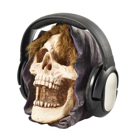 detestable: Headphones put on a ceramic skull head isolated over white background