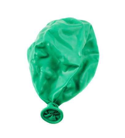 abandonment: Deflated green balloon isolated over white background