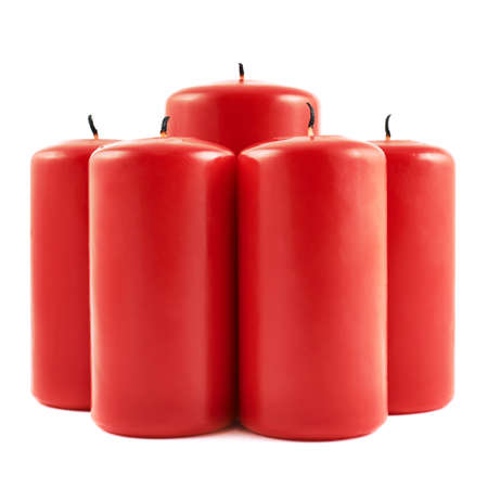 Five red candle with a burnt wick composition isolated over white background photo