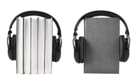 Audio-books concept composition as a stack of books with a headphones on it, isolated over white photo