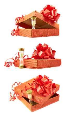 Sandglass and red gift box with a bow composition isolated over white photo
