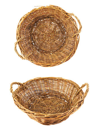 Brown wicker basket isolated over white photo