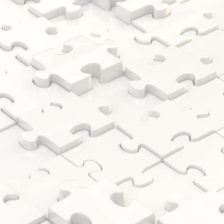 White puzzle pieces covered surface as an abstract background composition photo