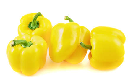 Pile of sweet bell pepper composition isolated over a white background photo