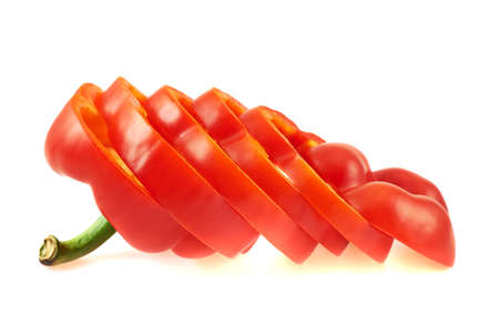 Sweet red bell pepper cut in slices isolated over white background Stock Photo
