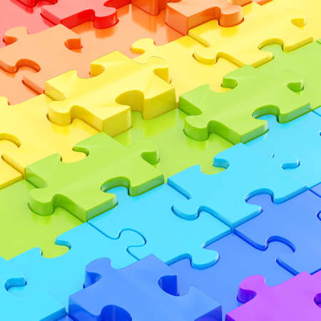 Colorful puzzle pieces covered surface as an abstract background composition photo