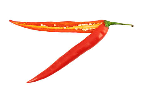 Cut in halves red chili pepper isolated over white background