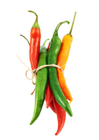 Tied bunch of chili peppers isolated over white background photo