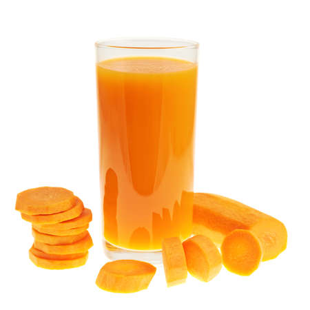 Sliced carrot pieces next to a juice bottle isolated over white background photo