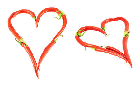 Heart shape made of chili peppers isolated over white background, set of two foreshortenings photo