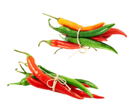 Tied bunch of chili peppers isolated over white background, set of two foreshortenings photo