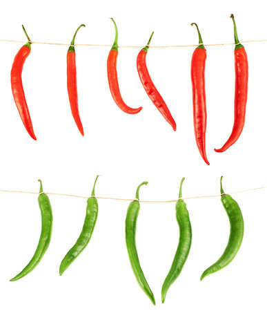 Tied chili peppers isolated over white background, set of two compositions, red and green