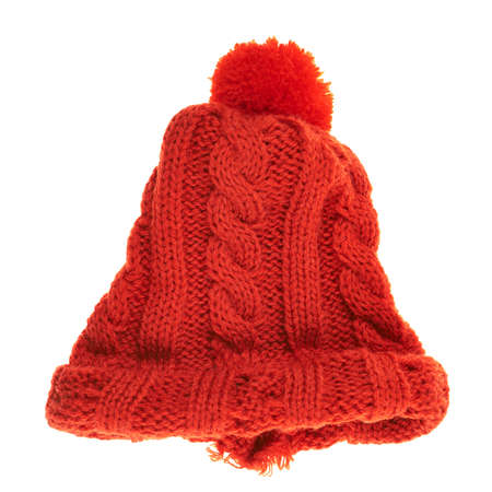 pompon: Knitted winter red cap isolated over white background