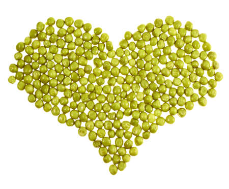 Heart shape made of green peas isolated over white background