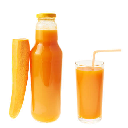 Carrot juice composition of bottle, carrot and full glass isolated over white background photo