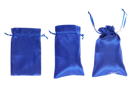 Blue drawstring bag packaging isolated over white background, set of three images as a process of folding and closing an opened one photo