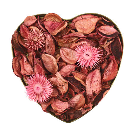 medley: Heart shaped container filled with red medley potpourri isolated over white background