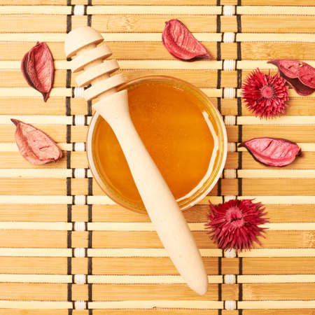 compostion: Honey dipper, jar and potpourri compostion Stock Photo