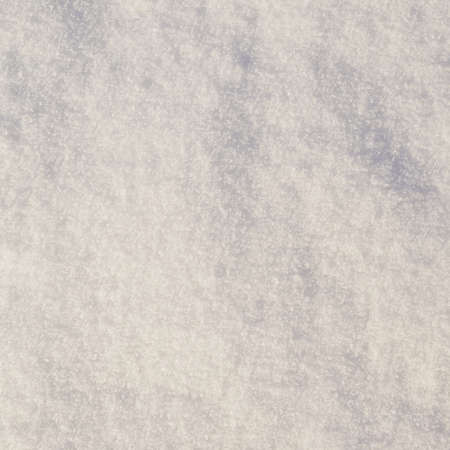 Surface covered with snow as a background texture photo