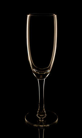 Champagne flute glass in the low-key lighting and surface reflection Stock Photo - 27043959