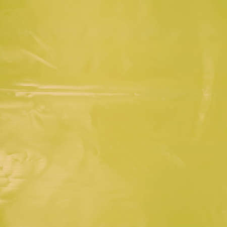 polyethylene film: Creased plastic yellow polyethylene film texture Stock Photo
