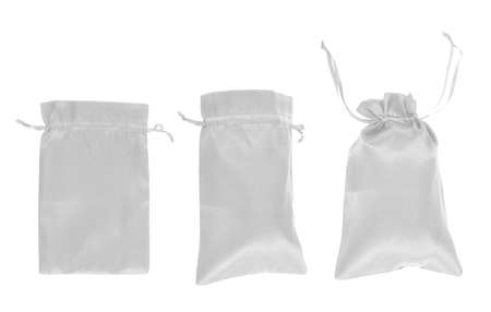 White drawstring bag packaging isolated over white background, set of three images as a process of folding and closing an opened one