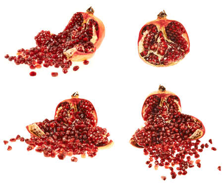 Opened pomegranate fruit with its seed lying around, isolated over white background, set of four foreshortenings photo